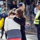 Woman comforts another after explosions interrupted the 117th Boston Marathon