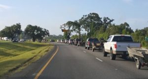 The Acadian Armada lines up on I-12 to launch their relief effort.